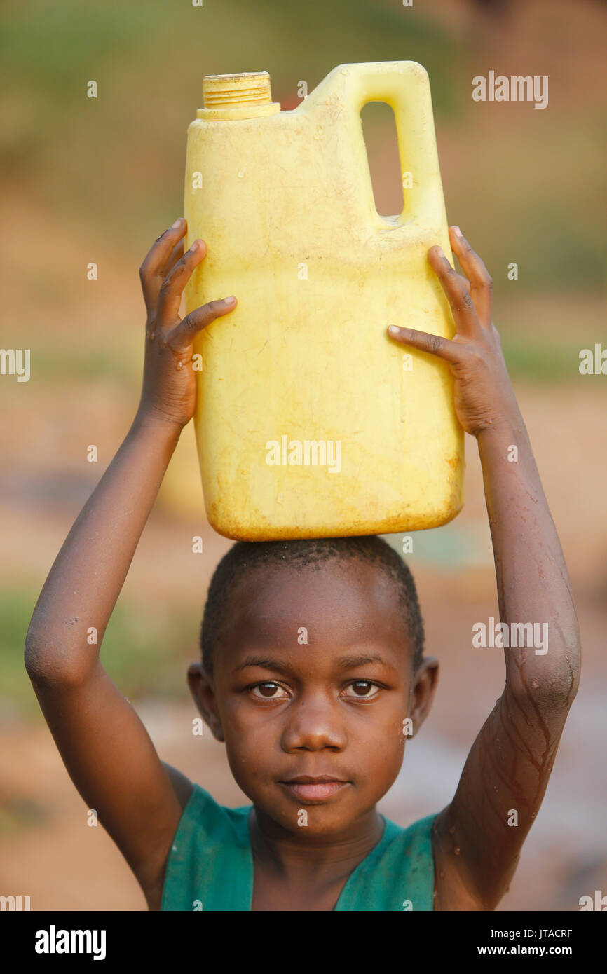 Fetching water in Mulago, Kampala, Uganda, Africa - Stock Image