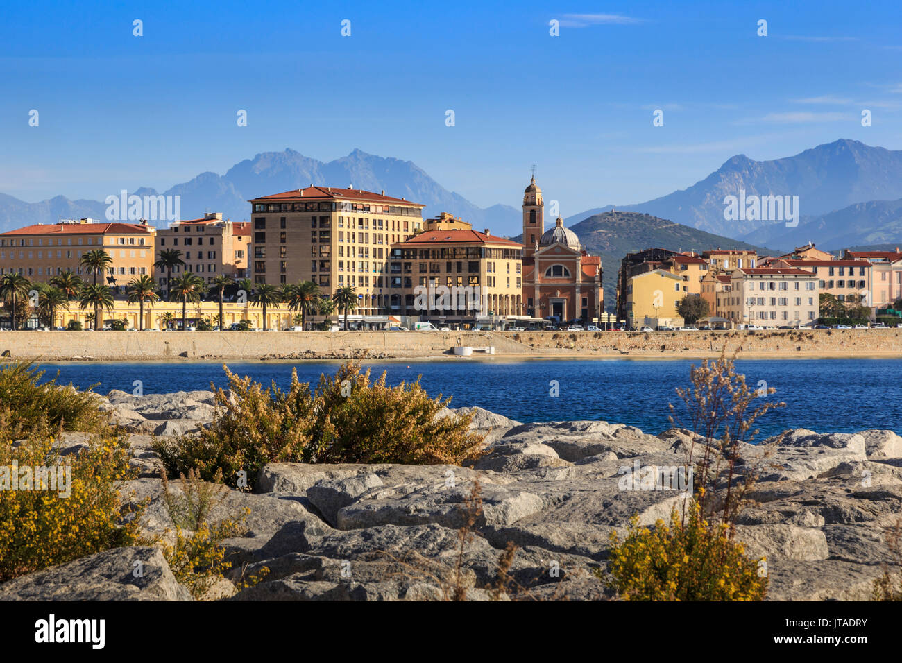 Cathedral, city and hazy mountains, from its rocky waterfont, Ajaccio, Island of Corsica, Mediterranean, France, - Stock Image
