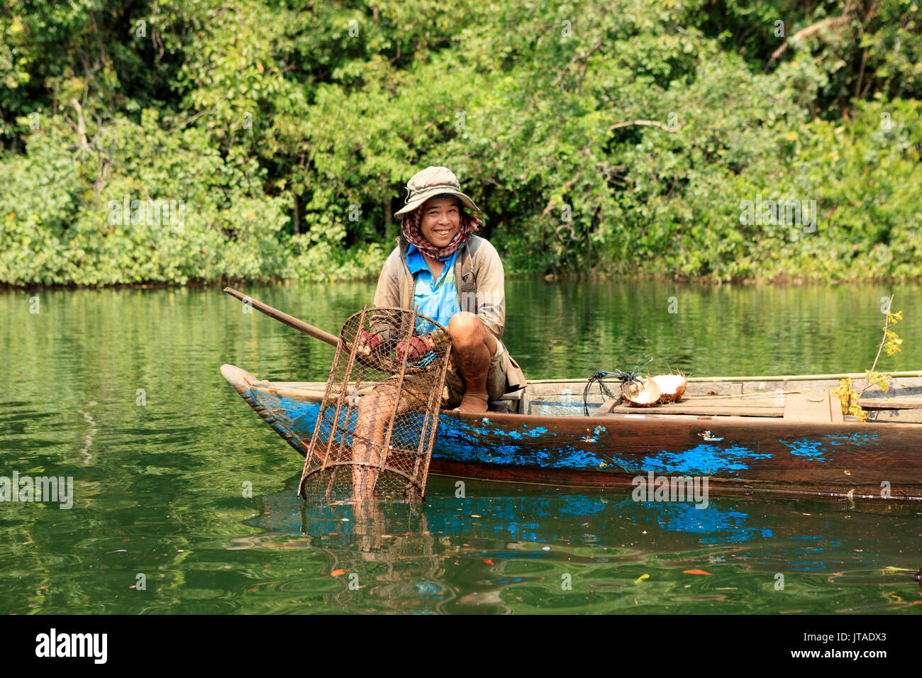 Crayfish fisherman on a tributary of the Phipot River in the Cardamom mountains, Koh Kong, Cambodia, Indochina, - Stock Image