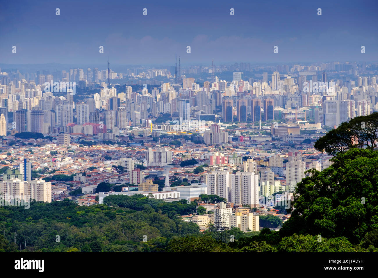 Central Sao Paulo from the rainforest of the Serra da Cantareira State Park, Sao Paulo, Brazil - Stock Image