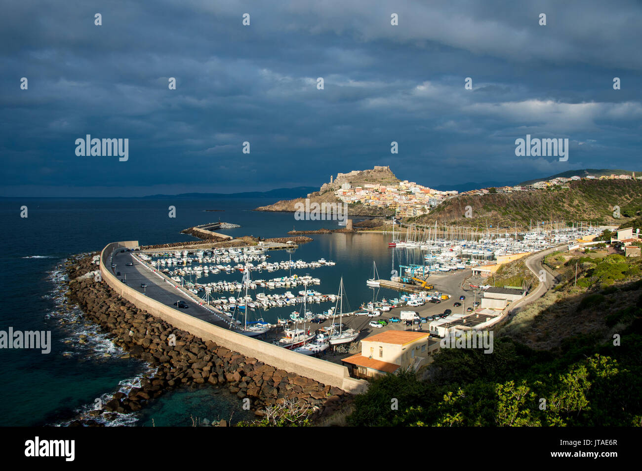 Dramatic light over the old town of Castelsardo with its boat harbour, Sardinia, Italy, Mediterranean, Europe - Stock Image