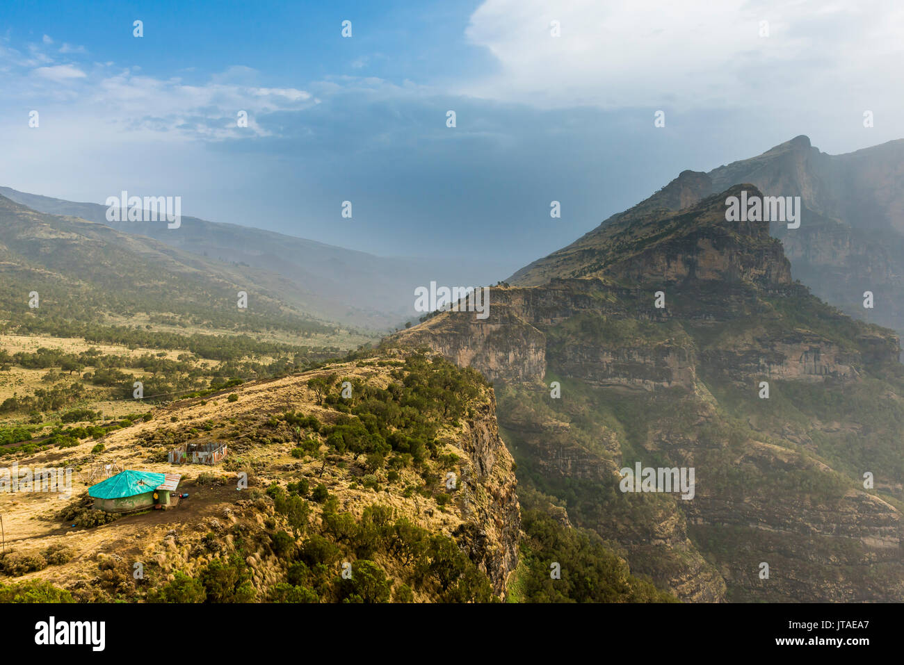 Community house on the edge of a cliff, Simien Mountains National Park, UNESCO World Heritage Site, Debarq, Ethiopia, Africa - Stock Image