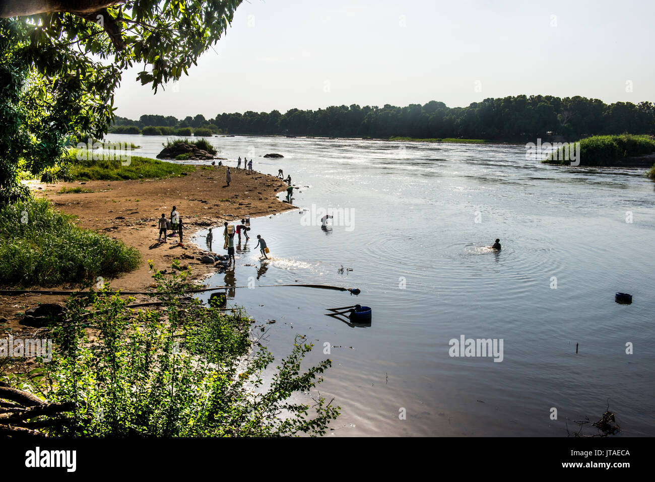 Local people playing in the waters of the White Nile River, Juba, South Sudan, Africa - Stock Image