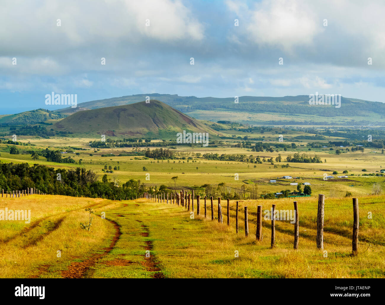 Landscape of the island seen from the way up to the Maunga Terevaka, Easter Island, Chile - Stock Image