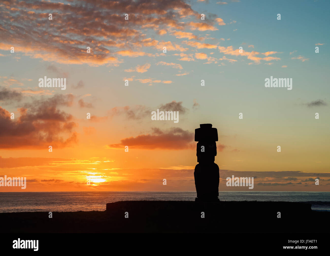Moai in Ahu Ko Te Riku at sunset, Tahai Archaeological Complex, Rapa Nui National Park, UNESCO, Easter Island, Chile - Stock Image