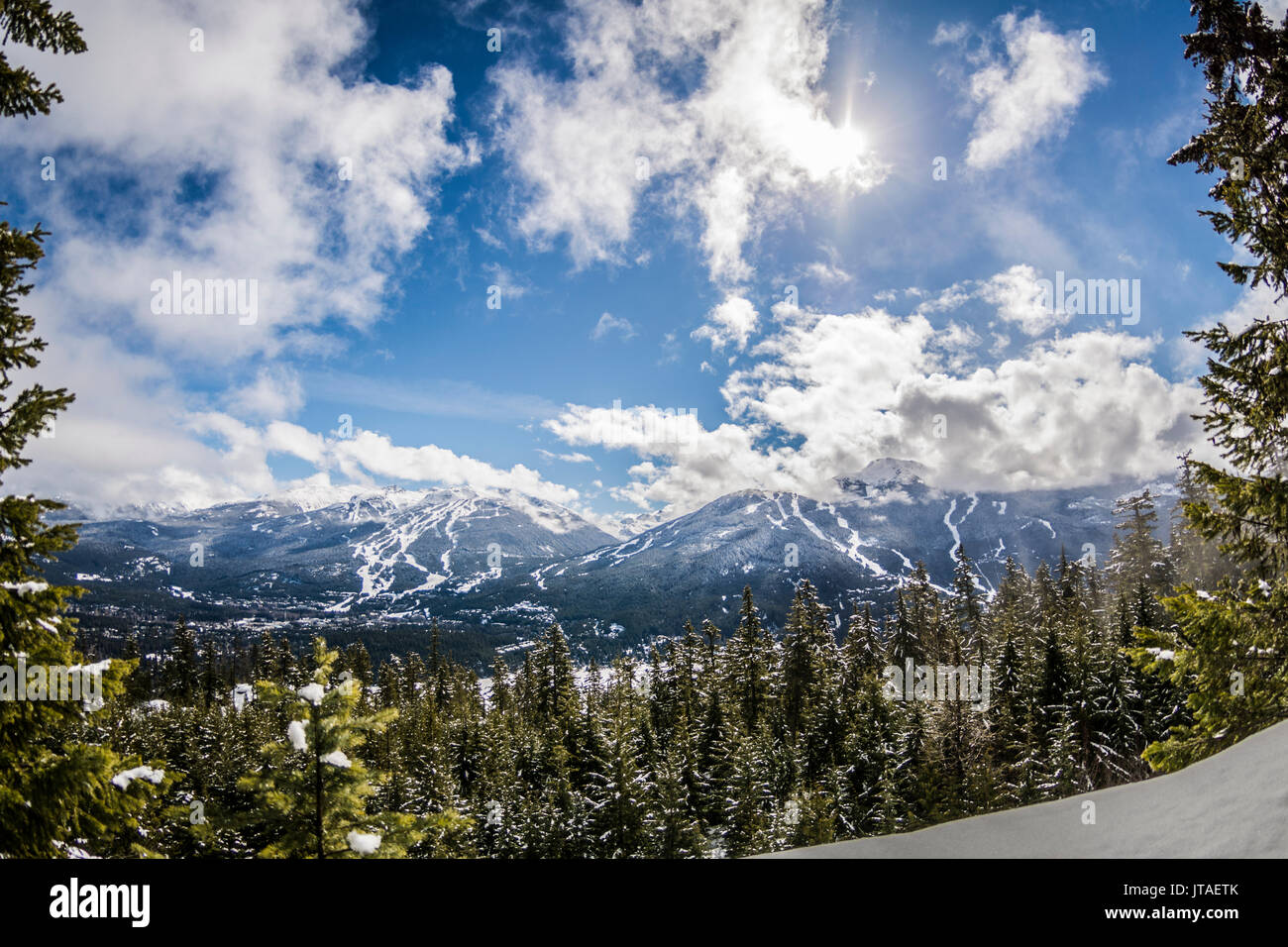 View of blue skies over Whistler Blackcomb from Sprout Mountain, British Columbia, Canada, North America Stock Photo