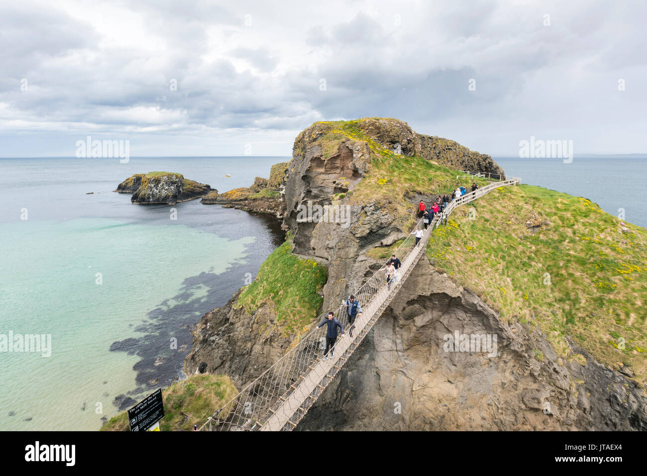 View of the Carrick a Rede Rope Bridge, Ballintoy, Ballycastle, County Antrim, Ulster, Northern Ireland, United Kingdom, Europe - Stock Image