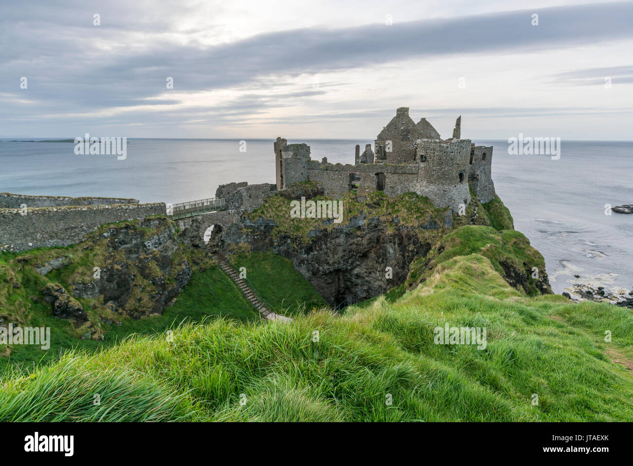 Dunluce Castle ruins, Bushmills, County Antrim, Ulster, Northern Ireland, United Kingdom, Europe - Stock Image