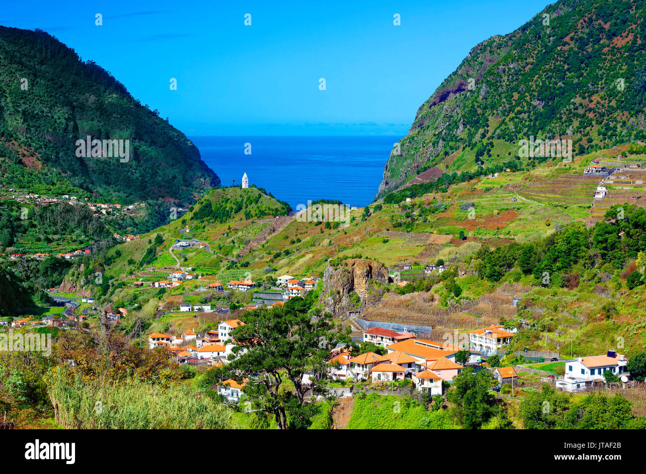 A distant view of Tower Chapel, looking towards Sao Vicente and the Atlantic Ocean, Madeira, Portugal, Atlantic - Stock Image