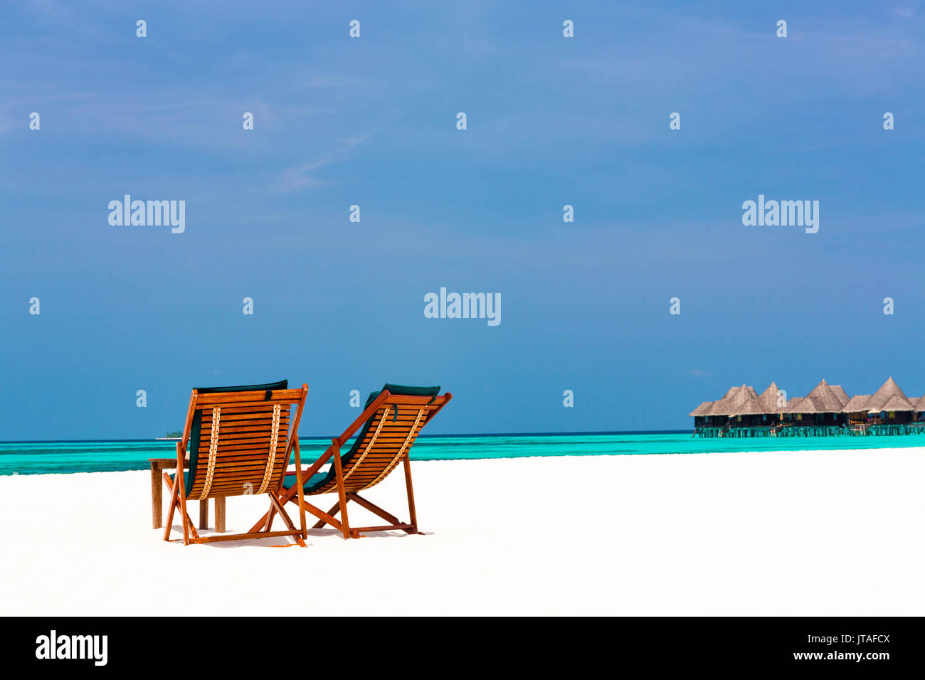 Wooden sun loungers on beach, Coco Palm, Dhuni Kolhu, Baa Atoll, Republic of Maldives, Indian Ocean, Asia - Stock Image