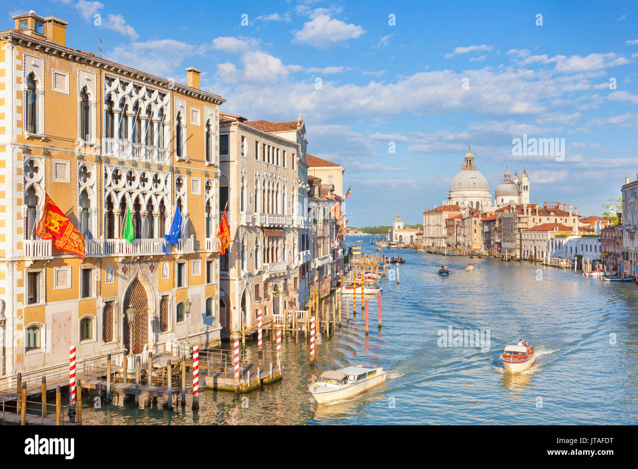 Vaporettos (water taxis) passing Palazzo Cavalli-Franchetti, on the Grand Canal, Venice, UNESCO, Veneto, Italy, Europe - Stock Image