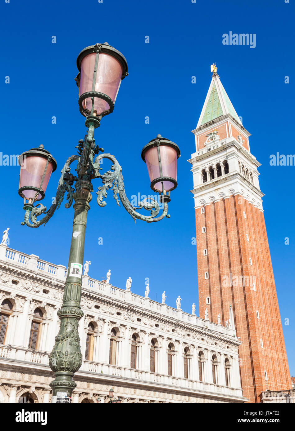 Campanile tower, traditional Venetian lamp post, Piazzetta, St. Marks Square, Venice, UNESCO, Veneto, Italy, Europe - Stock Image