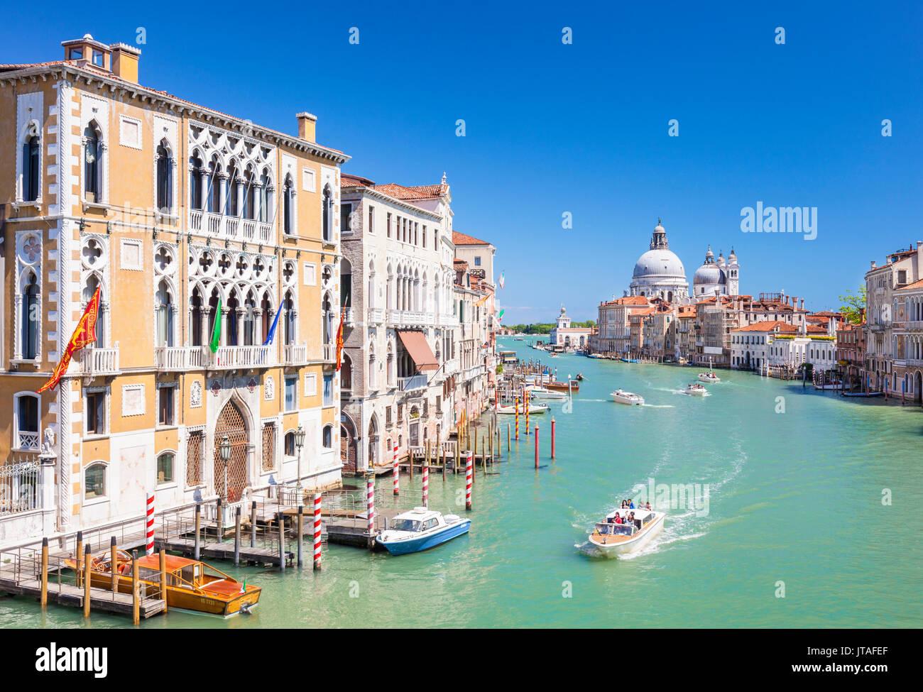Vaporettos passing Palazzo Cavalli-Franchetti and the Santa Maria della Salute on the Grand Canal, Venice, UNESCO, Veneto, Italy - Stock Image
