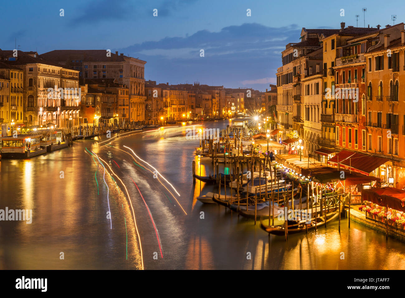 Grand Canal at night with boat light trails and moored gondolas, on the Fondementa del Vin, UNESCO, Venice, Veneto, Italy - Stock Image