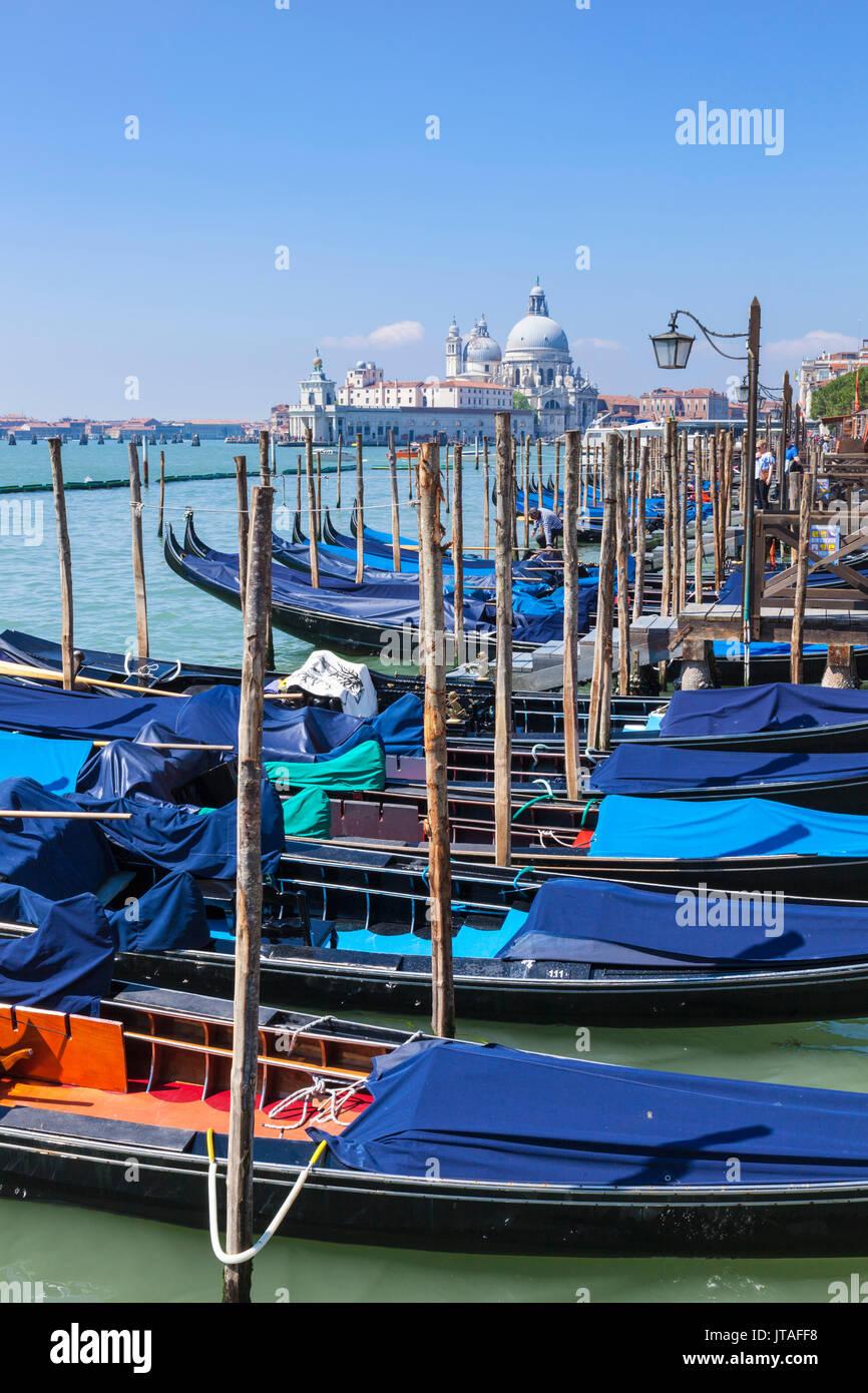 Gondolas moored in the Bacino di San Marco (St. Mark's Basin), waterfront, Venice, UNESCO, Veneto, Italy, Europe - Stock Image