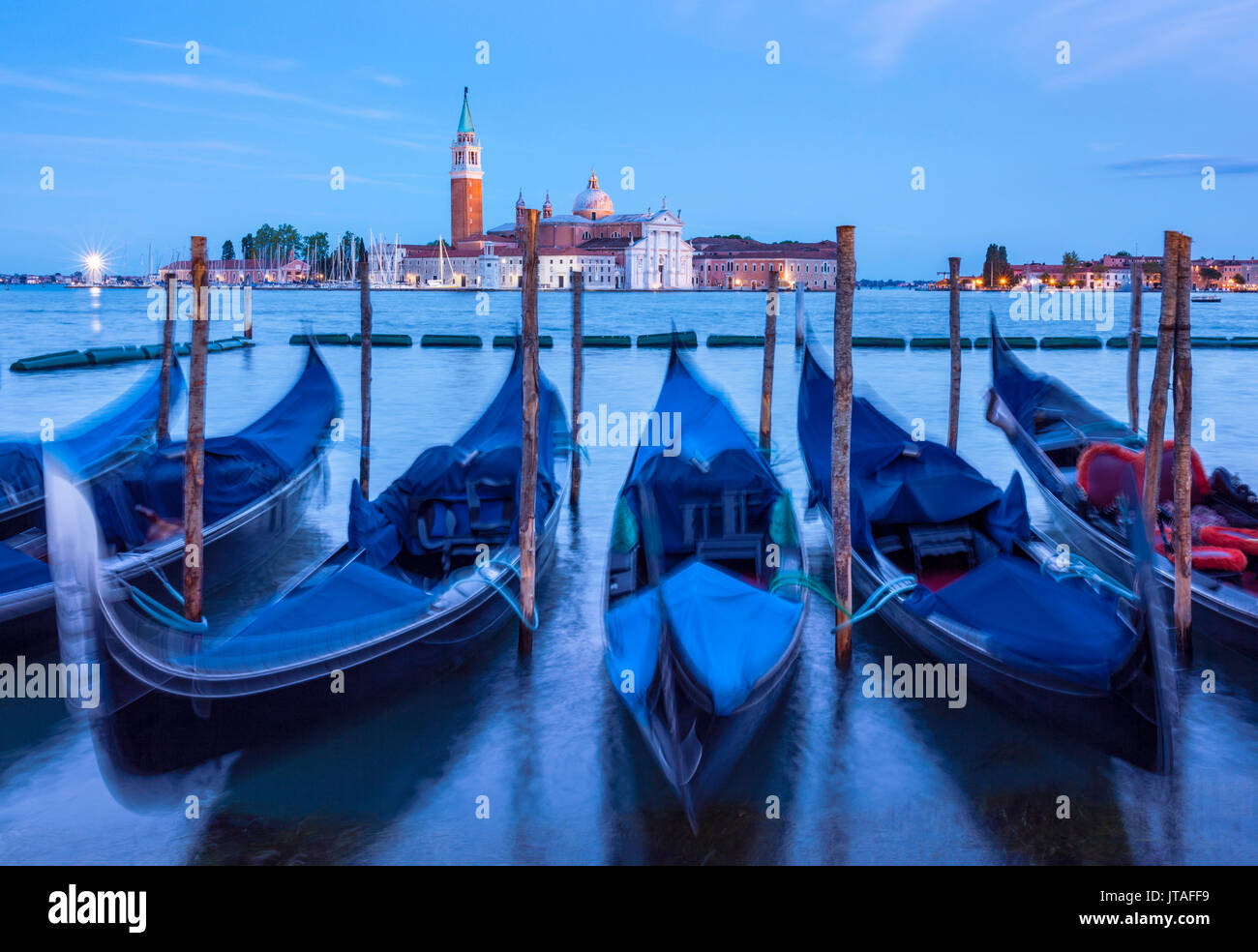 Gondolas moored at night in the Bacino di San Marco (St. Mark's Basin), waterfront, Venice, UNESCO, Veneto, Italy, Europe - Stock Image