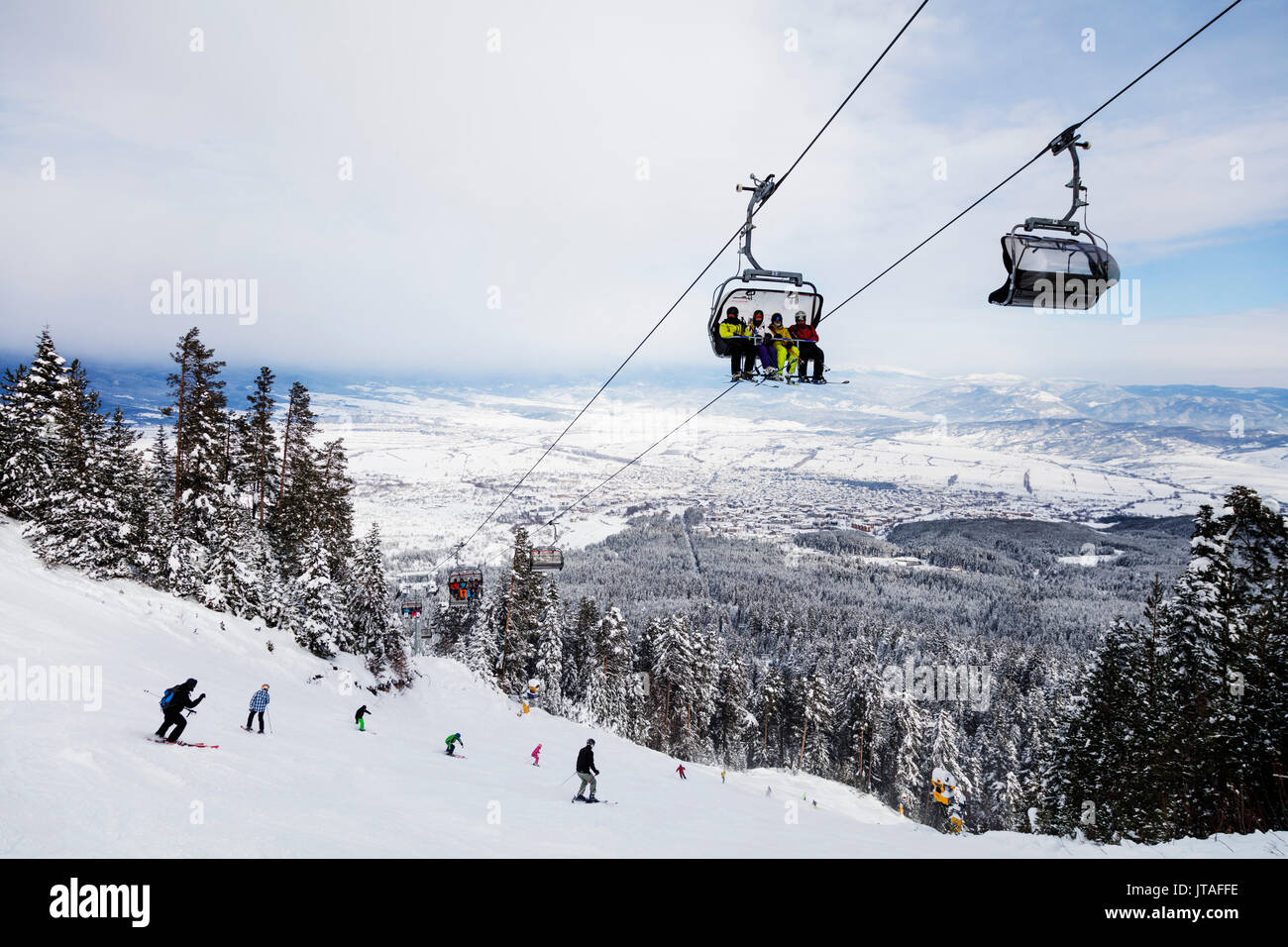 Piste skiers, Bansko resort, Bulgaria, Europe - Stock Image