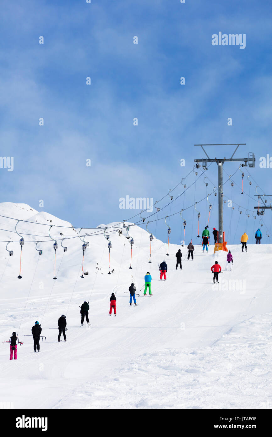 Skiers on a drag lift, Veysonnaz (Verbier), 4 Vallees, Valais, Swiss Alps, Switzerland, Europe - Stock Image