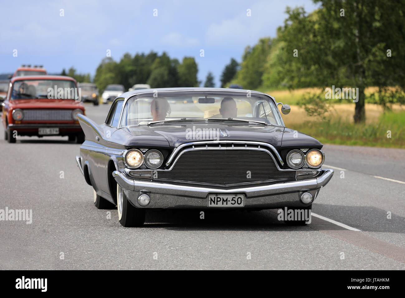 SOMERO, FINLAND - AUGUST 5, 2017: Black Chrysler Desoto Adventurer, probably 1960, moves along highway on Maisemaruise 2017 car cruise late summer eve - Stock Image