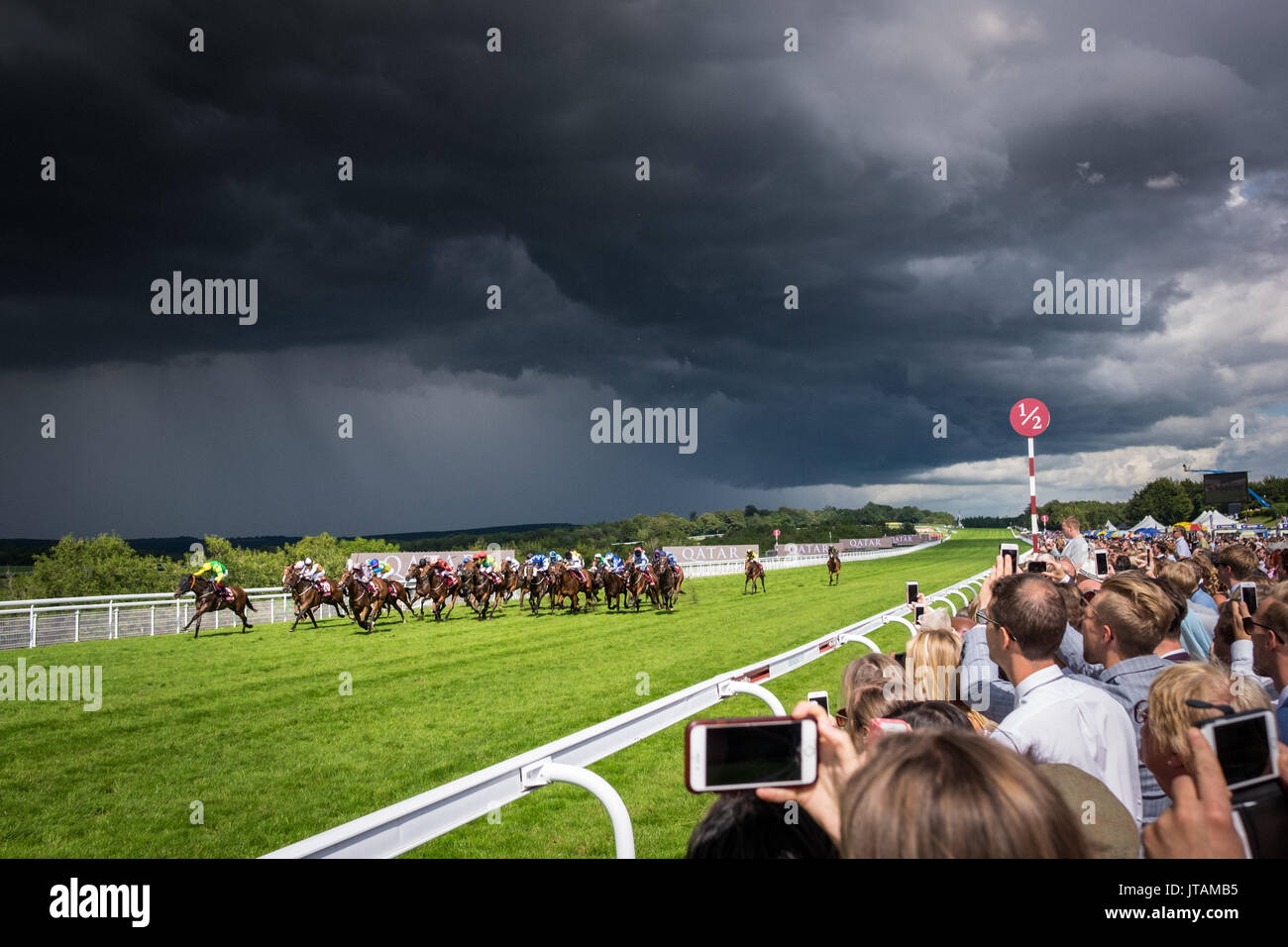 Storm clouds pass during the horse racing at Glorious Goodwood 2017 in West Sussex - Stock Image