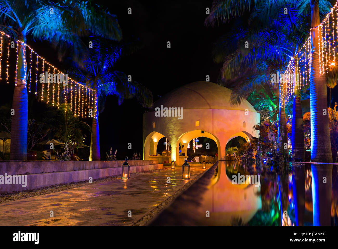Swahili Beach Resort Exterior Reflection Pools And Dome At Night With Lights, Diani, Kenya - Stock Image