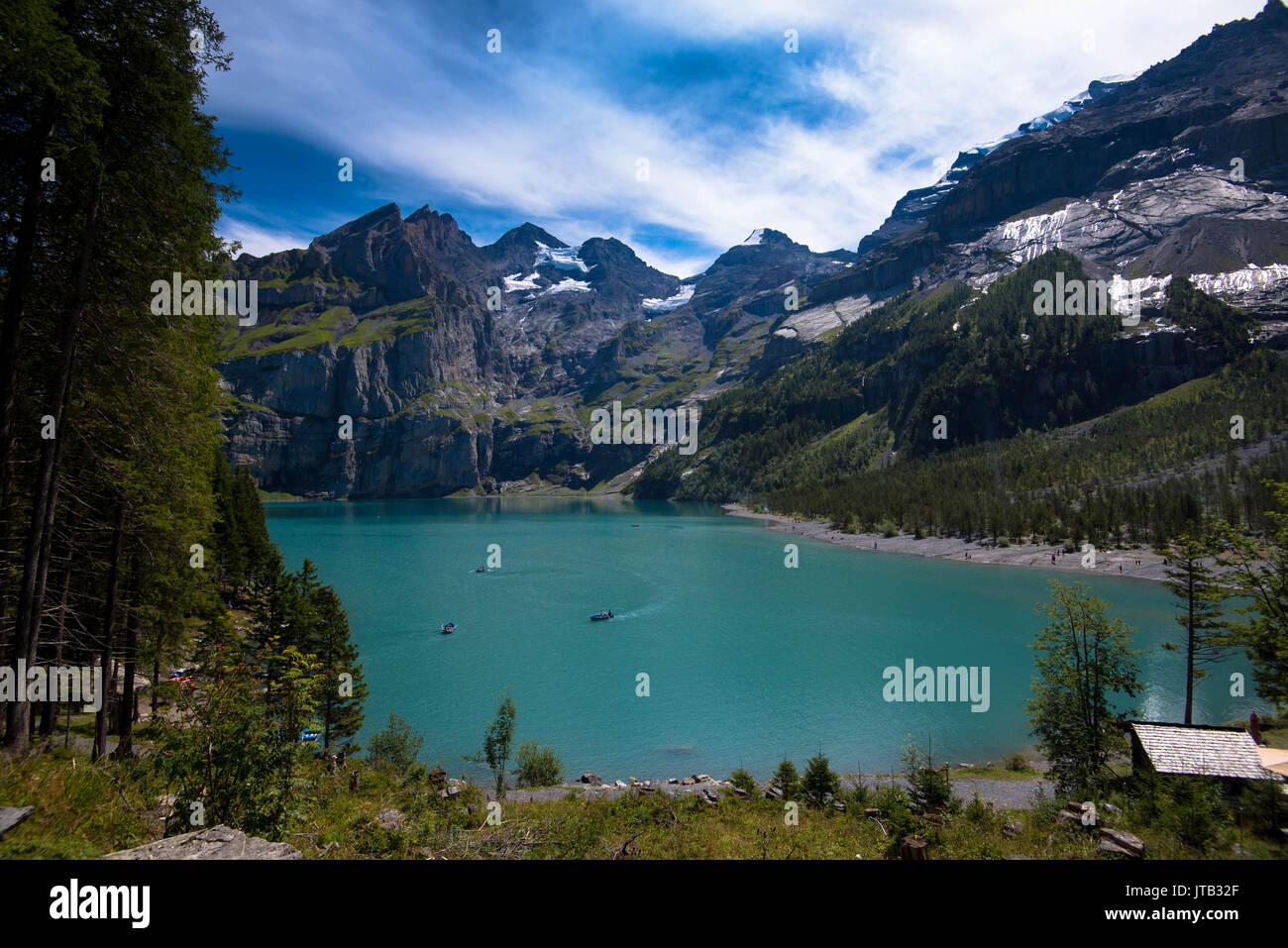 Beautiful lake Oeschinen in the heights of Kandersteg - Stock Image