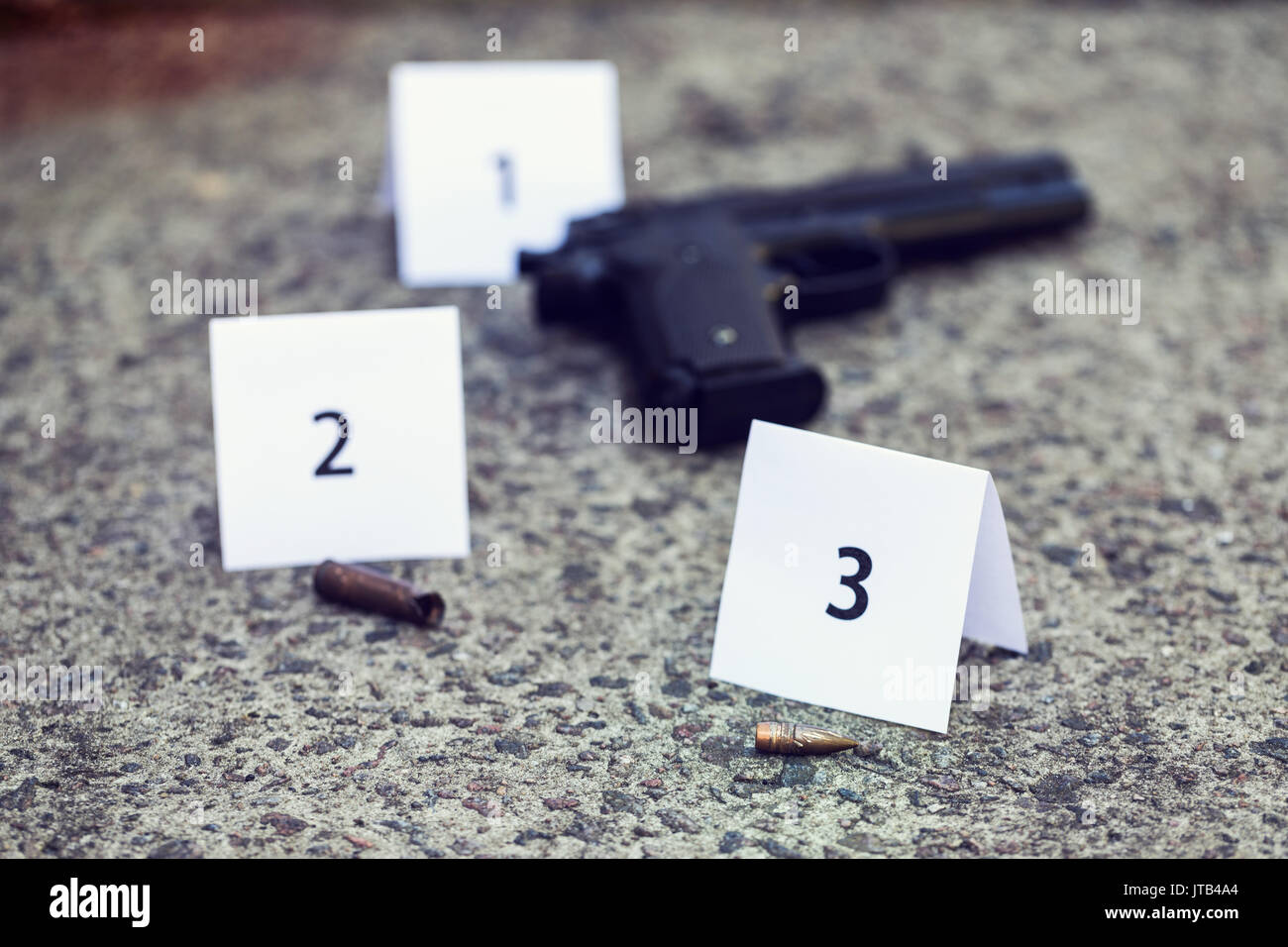 crime scene with evidences and markers on the asphalt - Stock Image