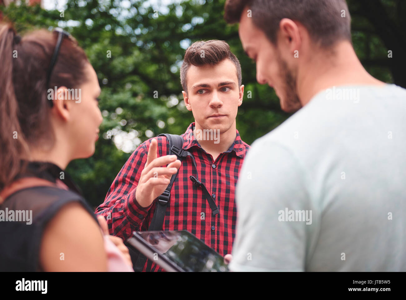 Angry man talking seriously outdoors - Stock Image