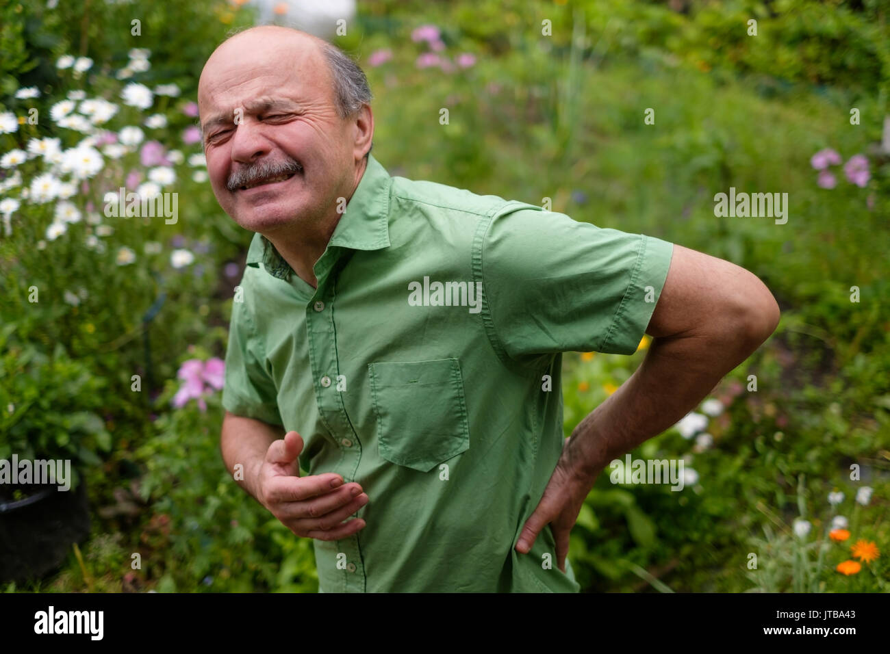 Old man having lumbago pain - Stock Image