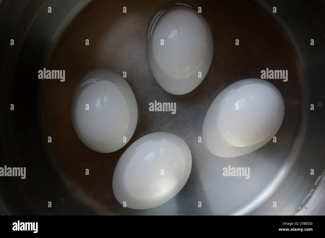 Eggs are waiting for boiling Stock Photo