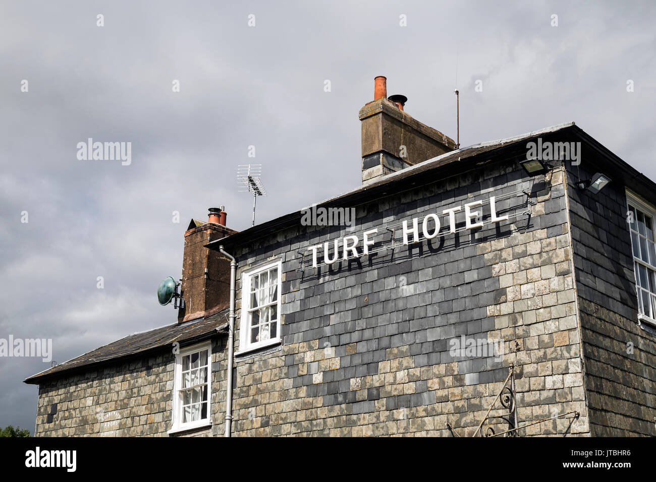 On the Exe Estuary the Exeter Canal and Turf Hotel or Turf locks a timber framed slate hung listed building.Exe Stock Photo