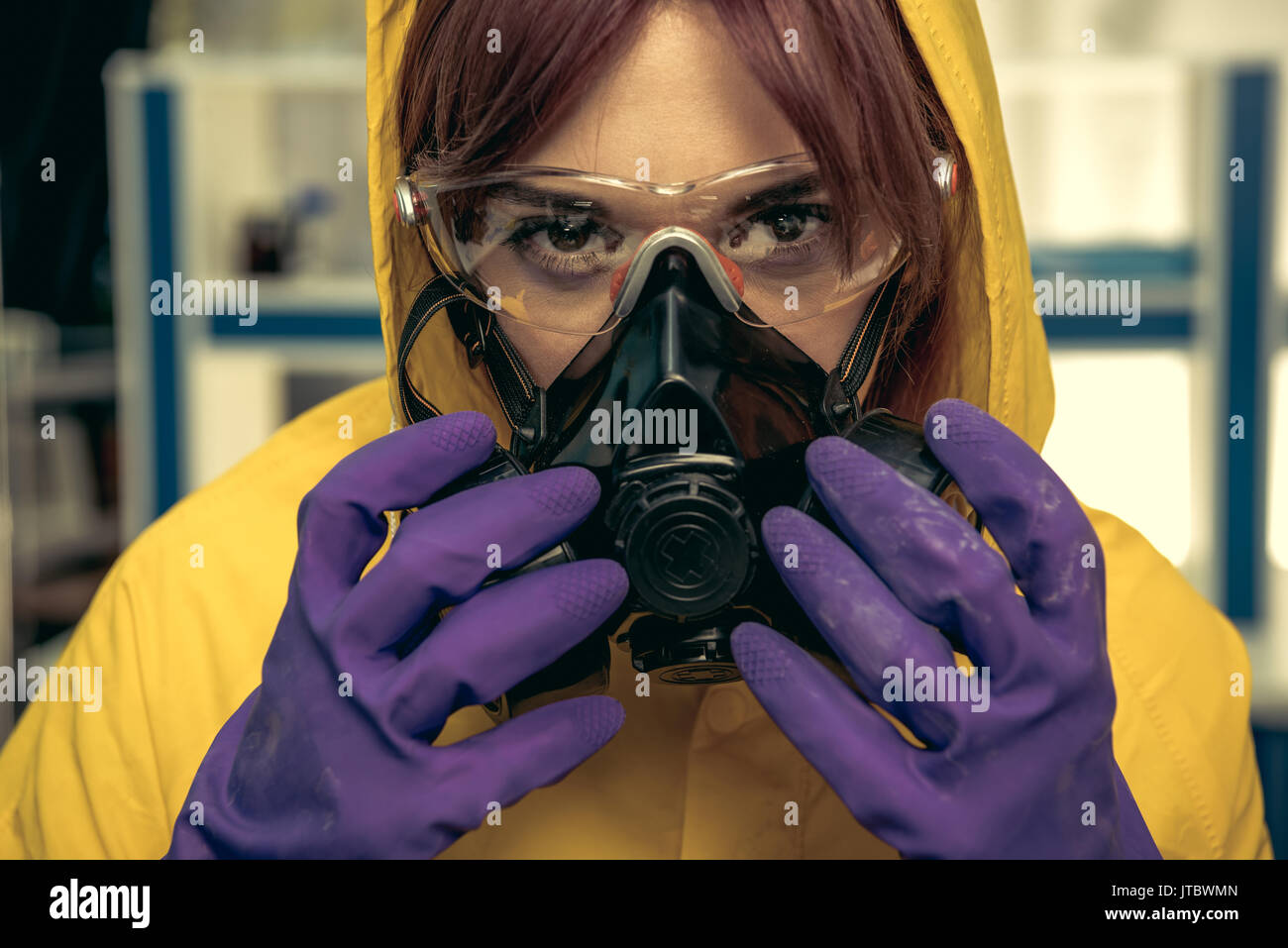 young girl laboratory technician in personal protective equipment, chemical lab Stock Photo