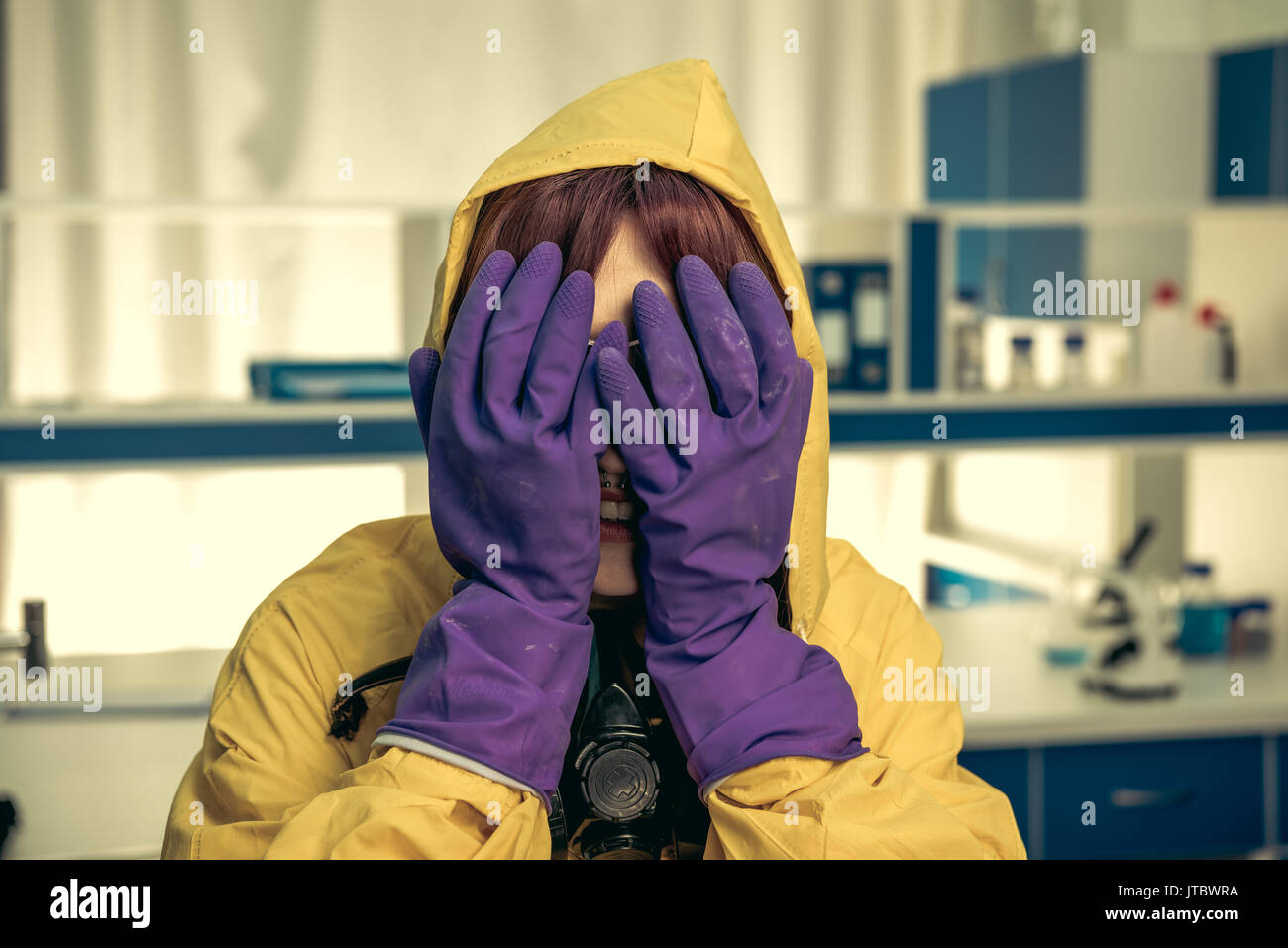young girl laboratory technician in personal protective equipment, chemical lab - Stock Image