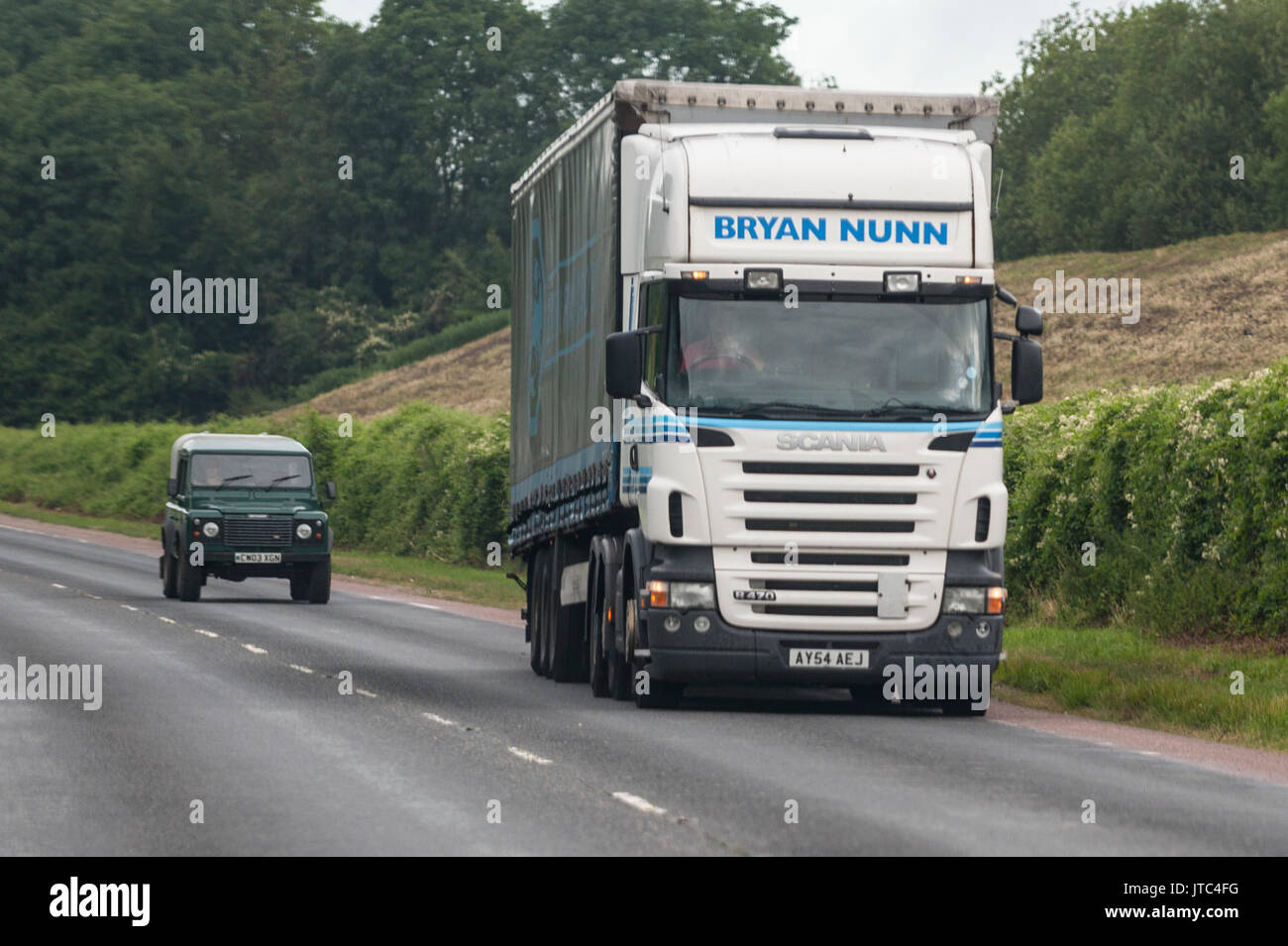 A Scania HGV lorry driving on a main road in the Uk - Stock Image