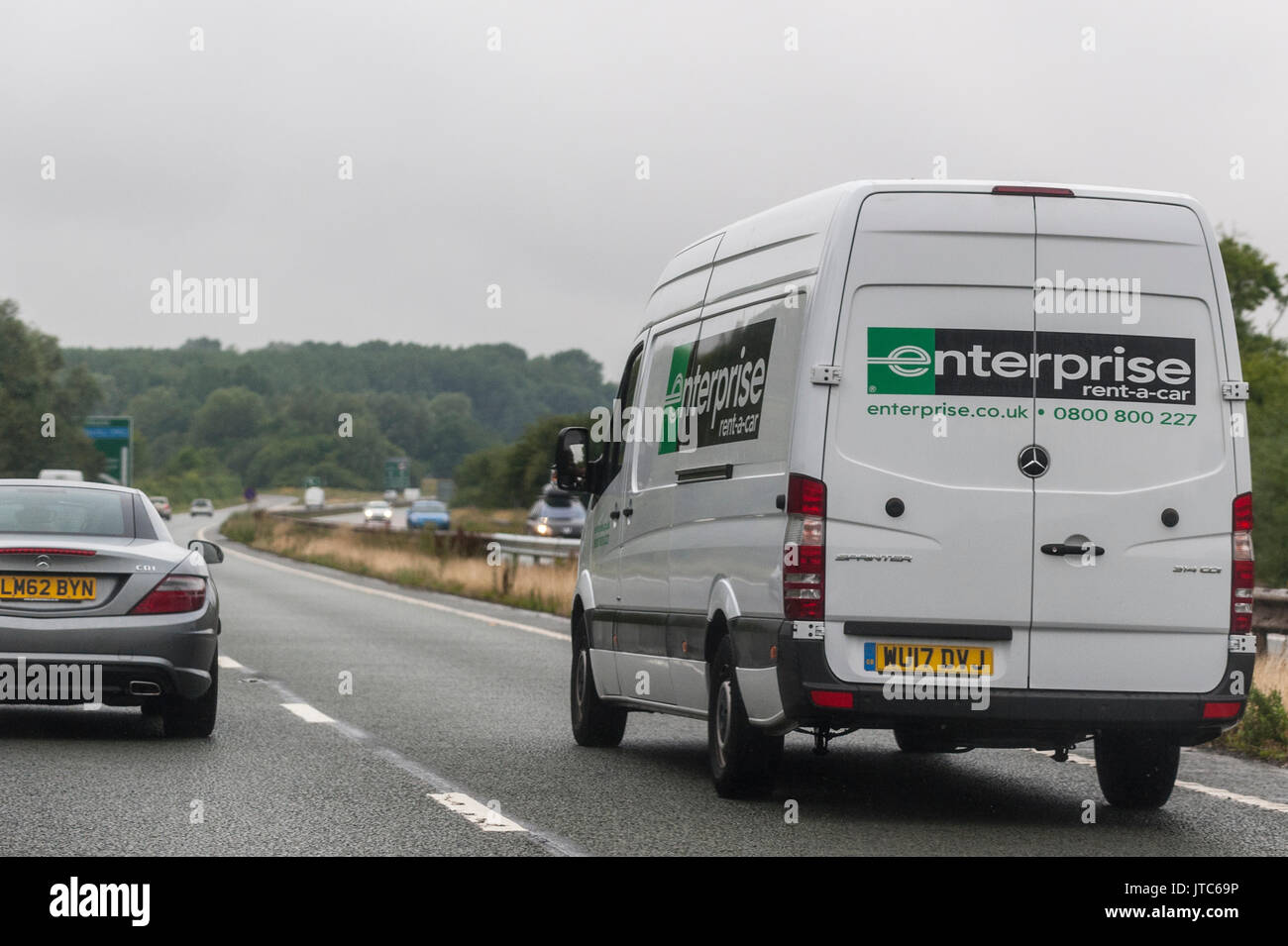 d339ad87c2 A Mercedes Sprinter enterprise rental van driving on a main road in the Uk  - Stock