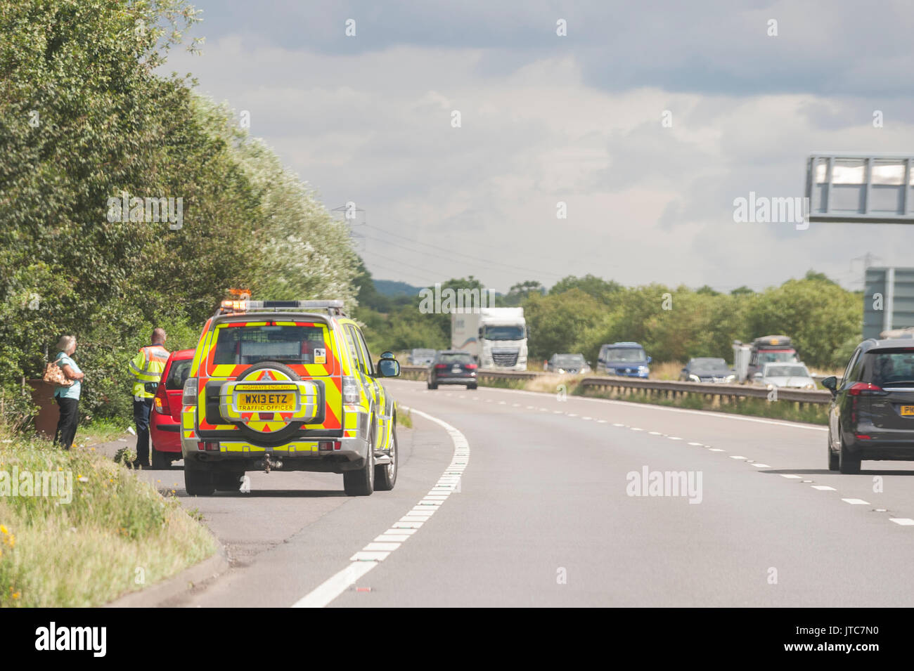 A Highways Traffic Officer on a main road in the Uk - Stock Image