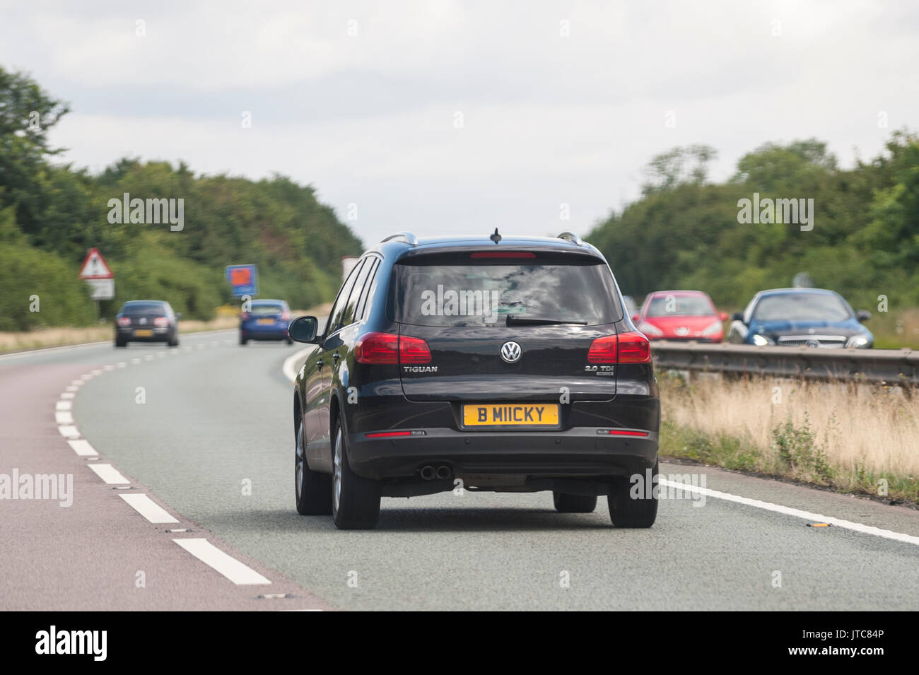 A VW Tiguan driving on a main road in the Uk - Stock Image