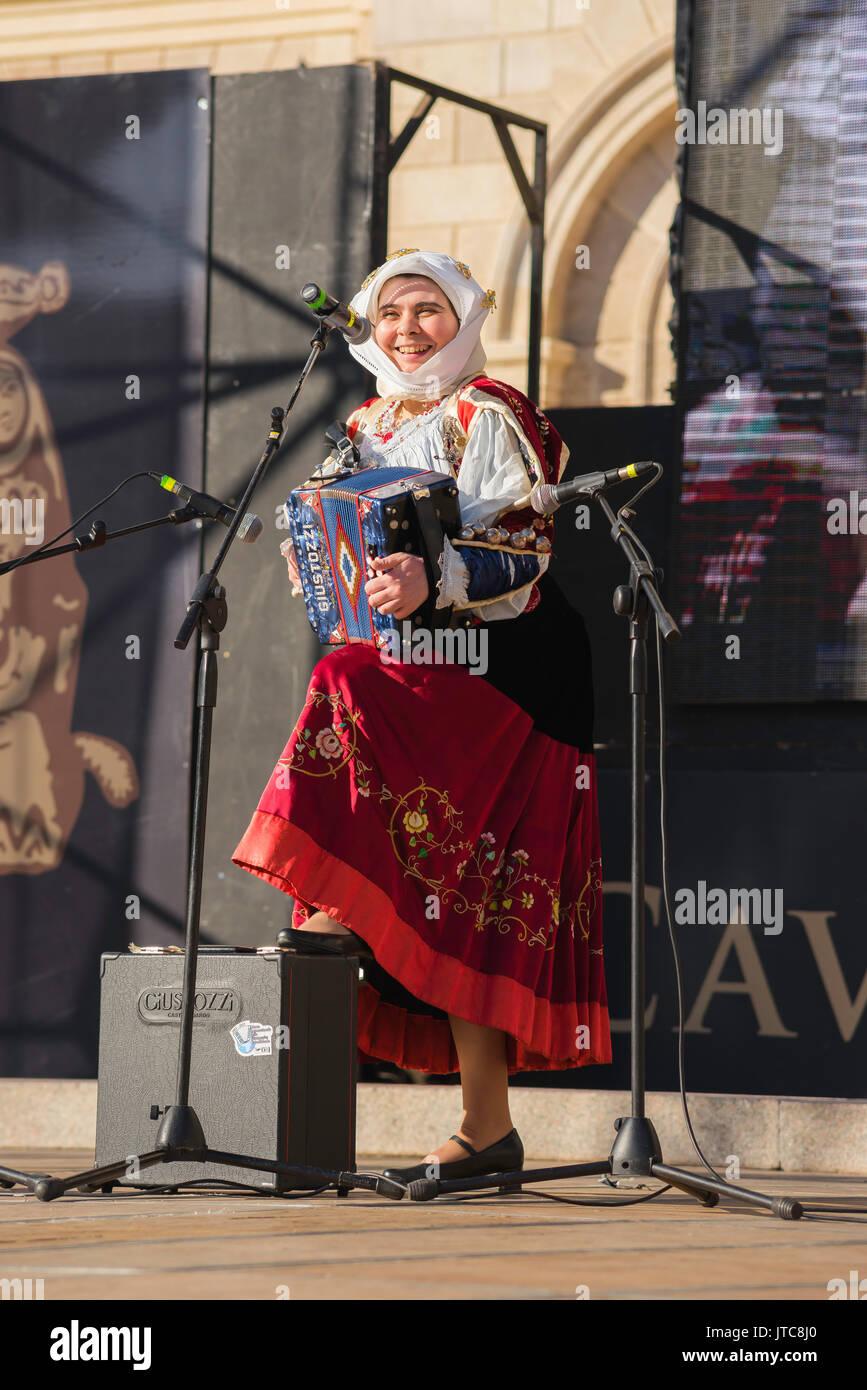 Sardinia folk music festival, a popular female accordionist performs in the La Cavalcata festival in Sassari, Sardinia. - Stock Image