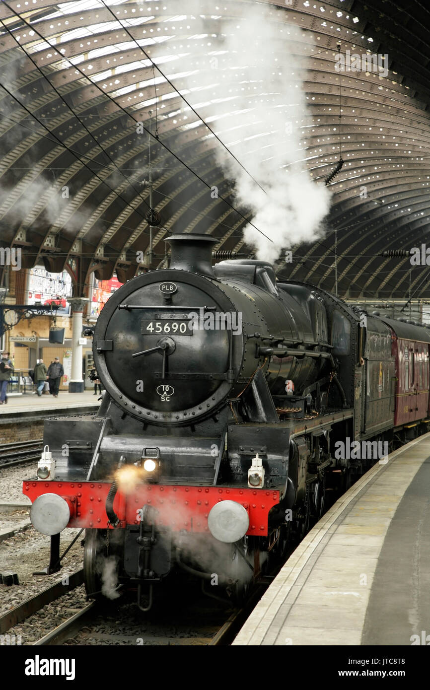 LMS Jubilee class steam locomotive 45690 'Leander' at York station, UK with the Scarborough Spa Express charter train - Stock Image