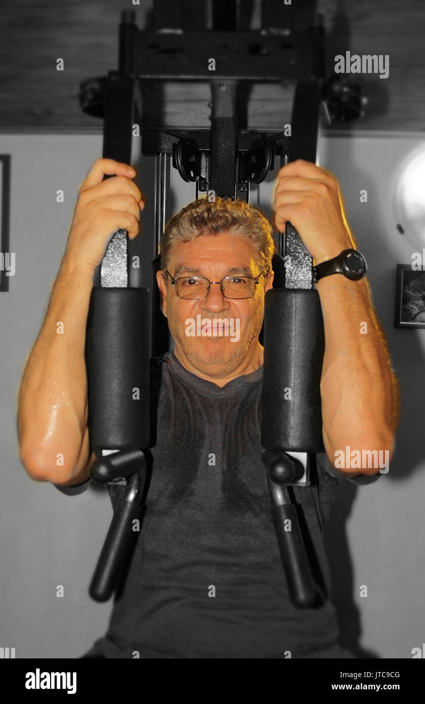Home gym in the attic, pectoral machine - Stock Image