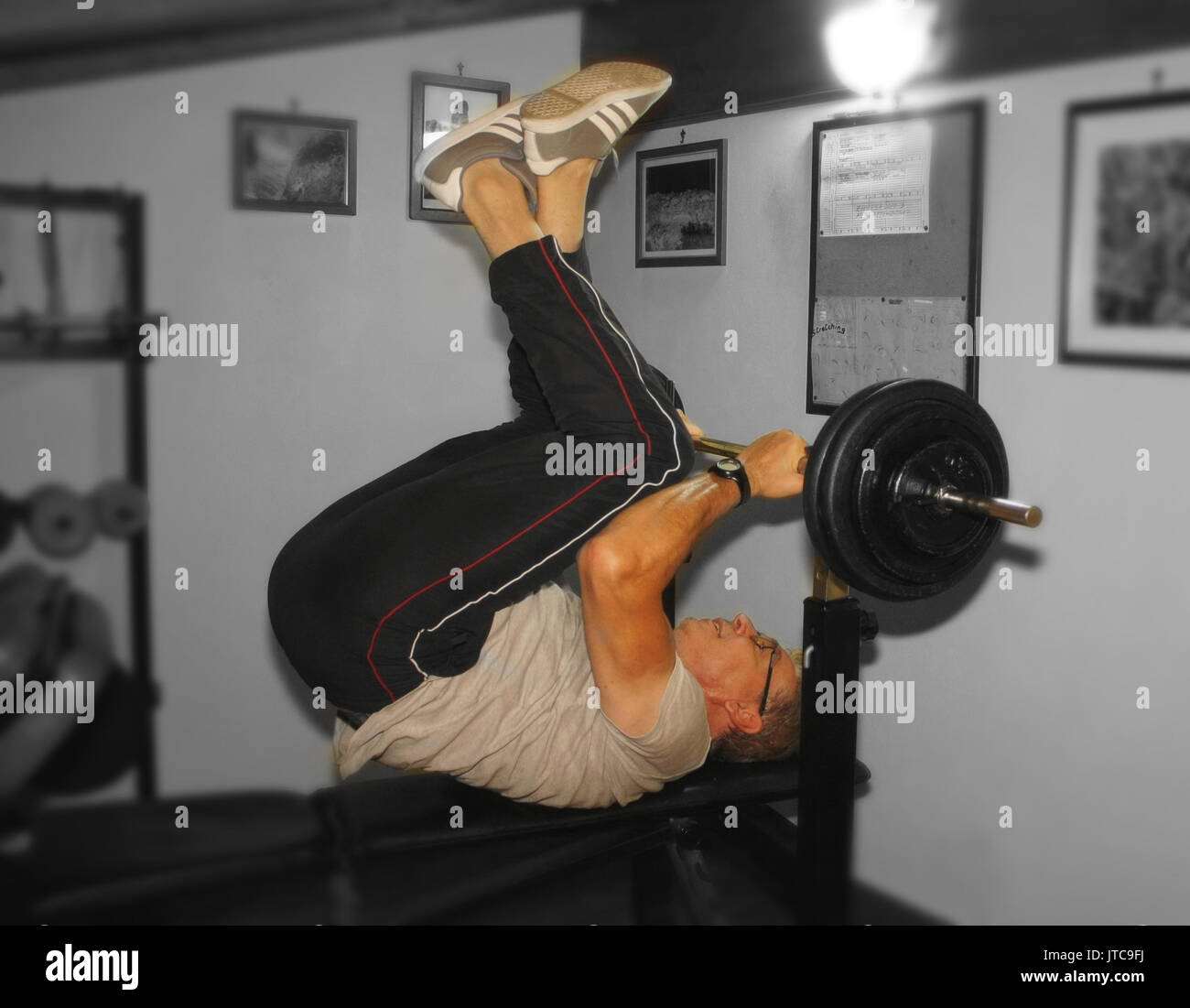 Home gym in the attic, reverse crunch on flat bench, for abdominal - Stock Image