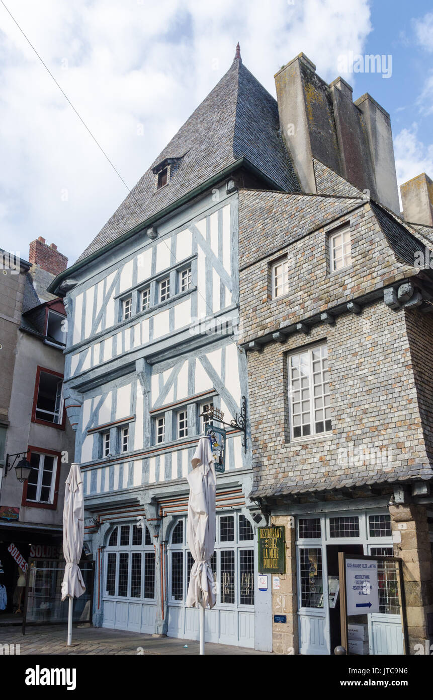 Old timber framed buildings in the historic walled town of Dinan in Brittany, France - Stock Image