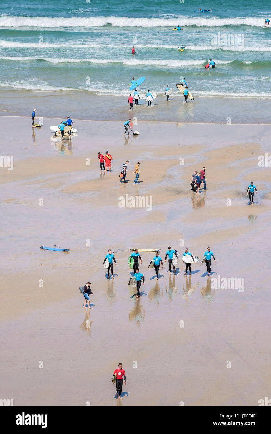Surf schools on Great Western beach in Newquay, Cornwall. - Stock Image