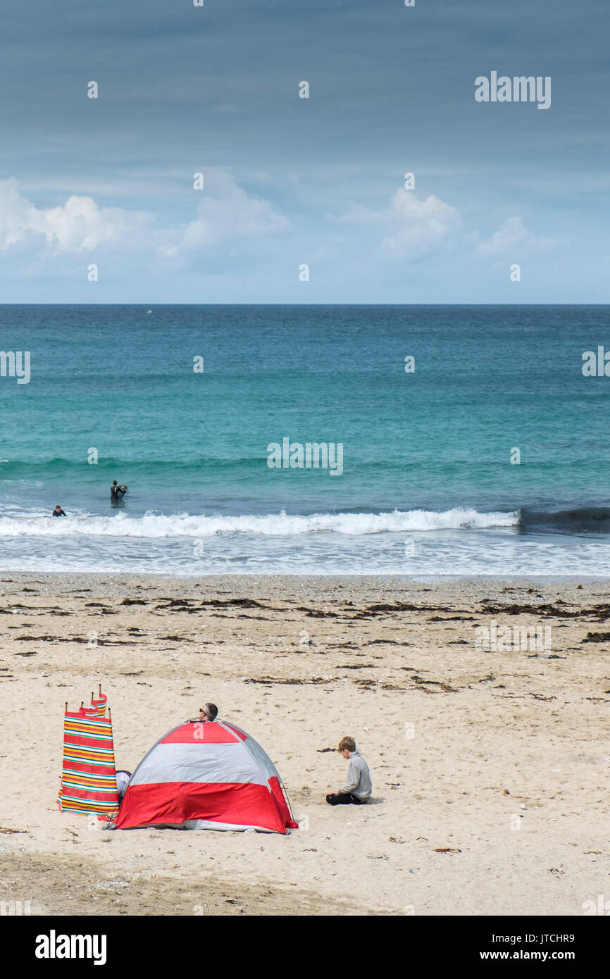 Holidaymakers on the beach at Gwithian Towans in Cornwall. - Stock Image