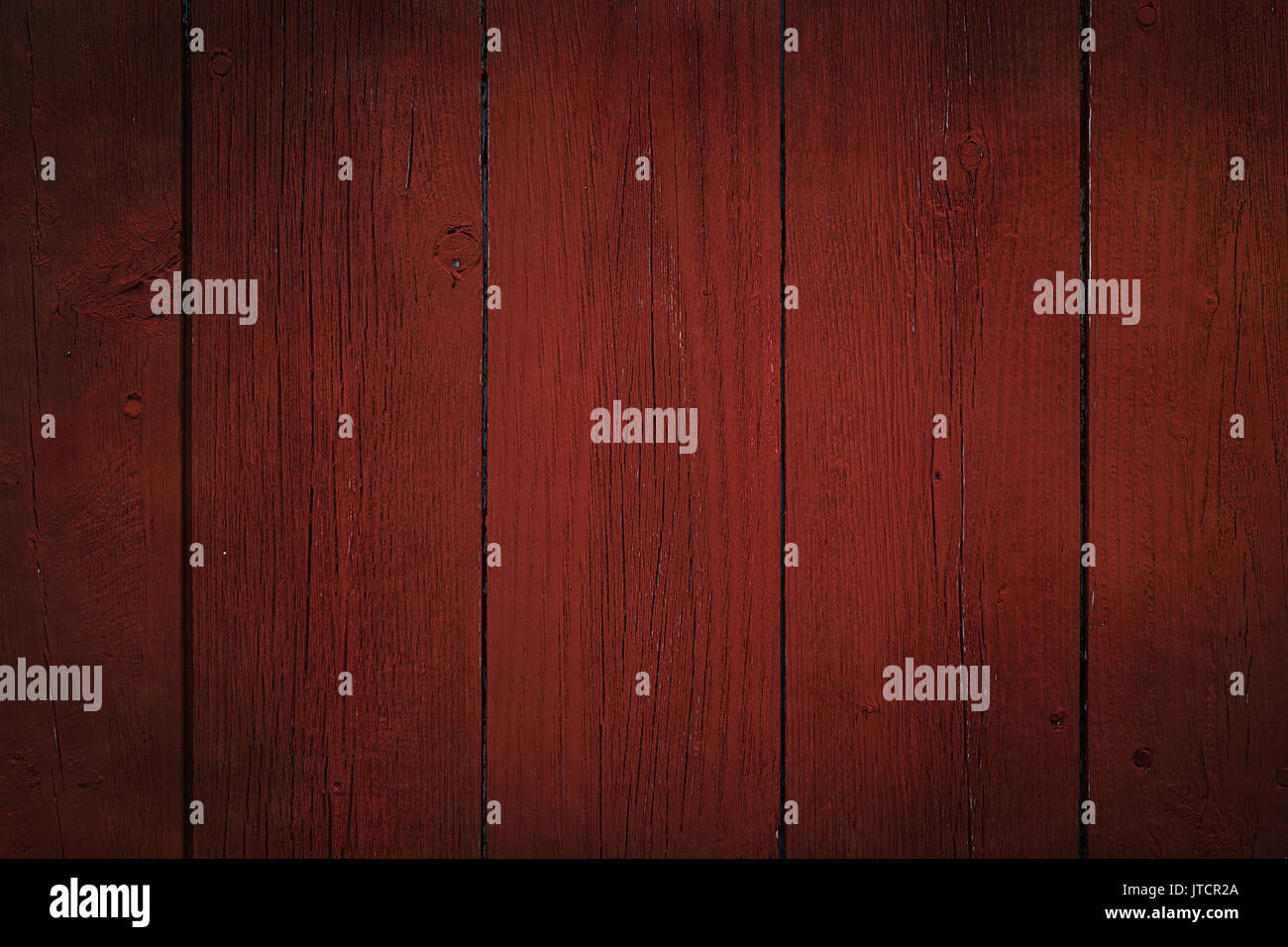 Dark red painted or stained board background. - Stock Image