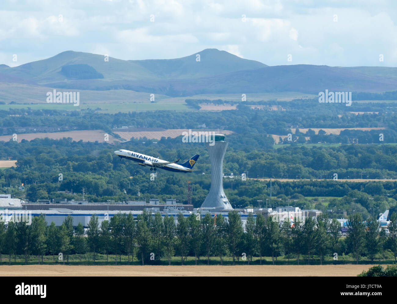 A ryanair passenger aircraft takes off from Edinburgh airport. - Stock Image