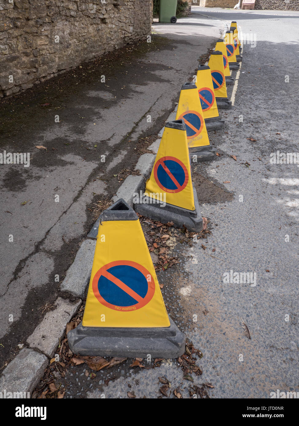 No waiting cones in a row on a side street in England. United Kingdom. - Stock Image