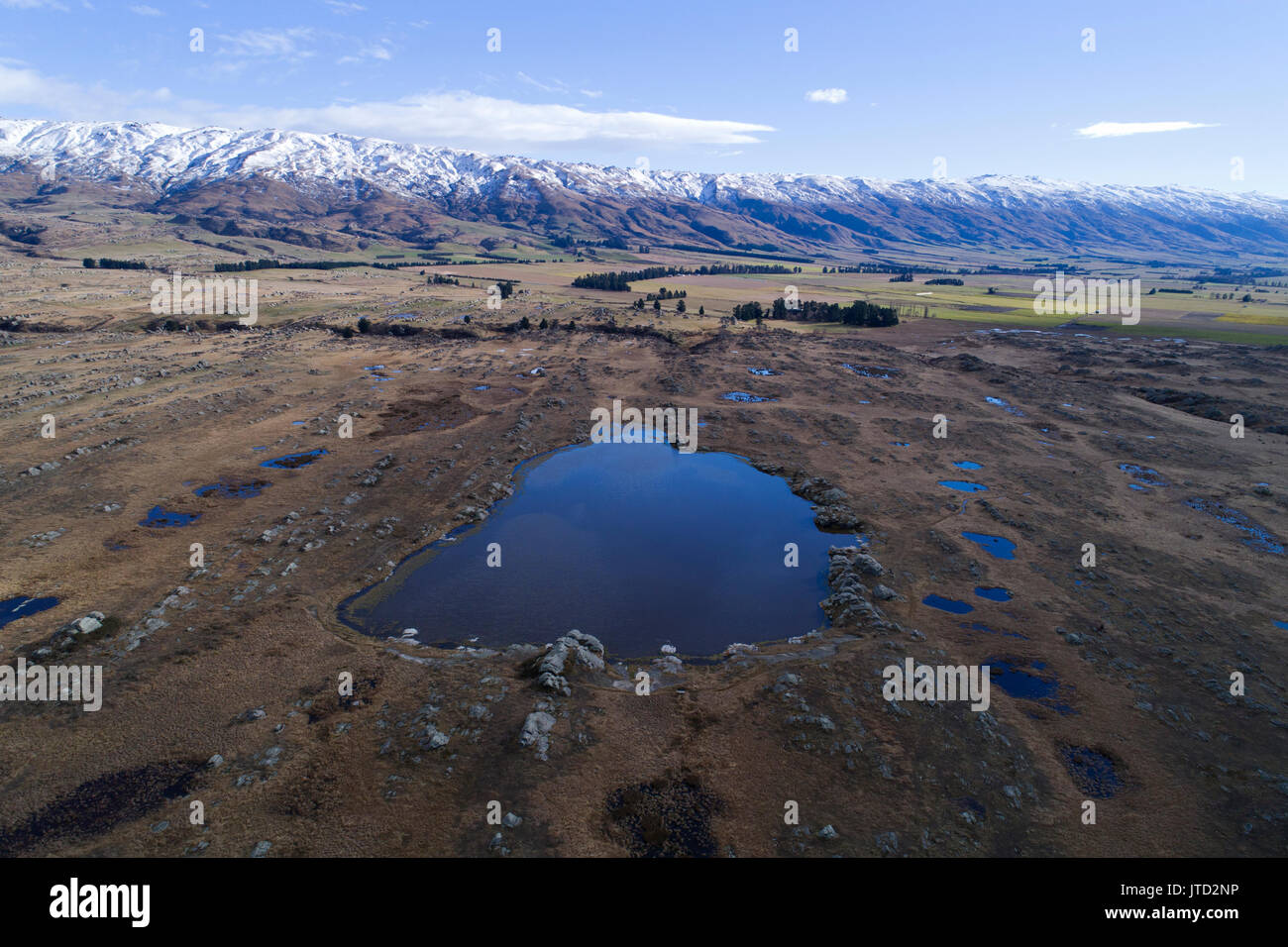 Sutton Salt Lake, and Rock and Pillar Range, Sutton, near Middlemarch, Strath Taieri, Otago, South Island, New Zealand - drone aerial - Stock Image