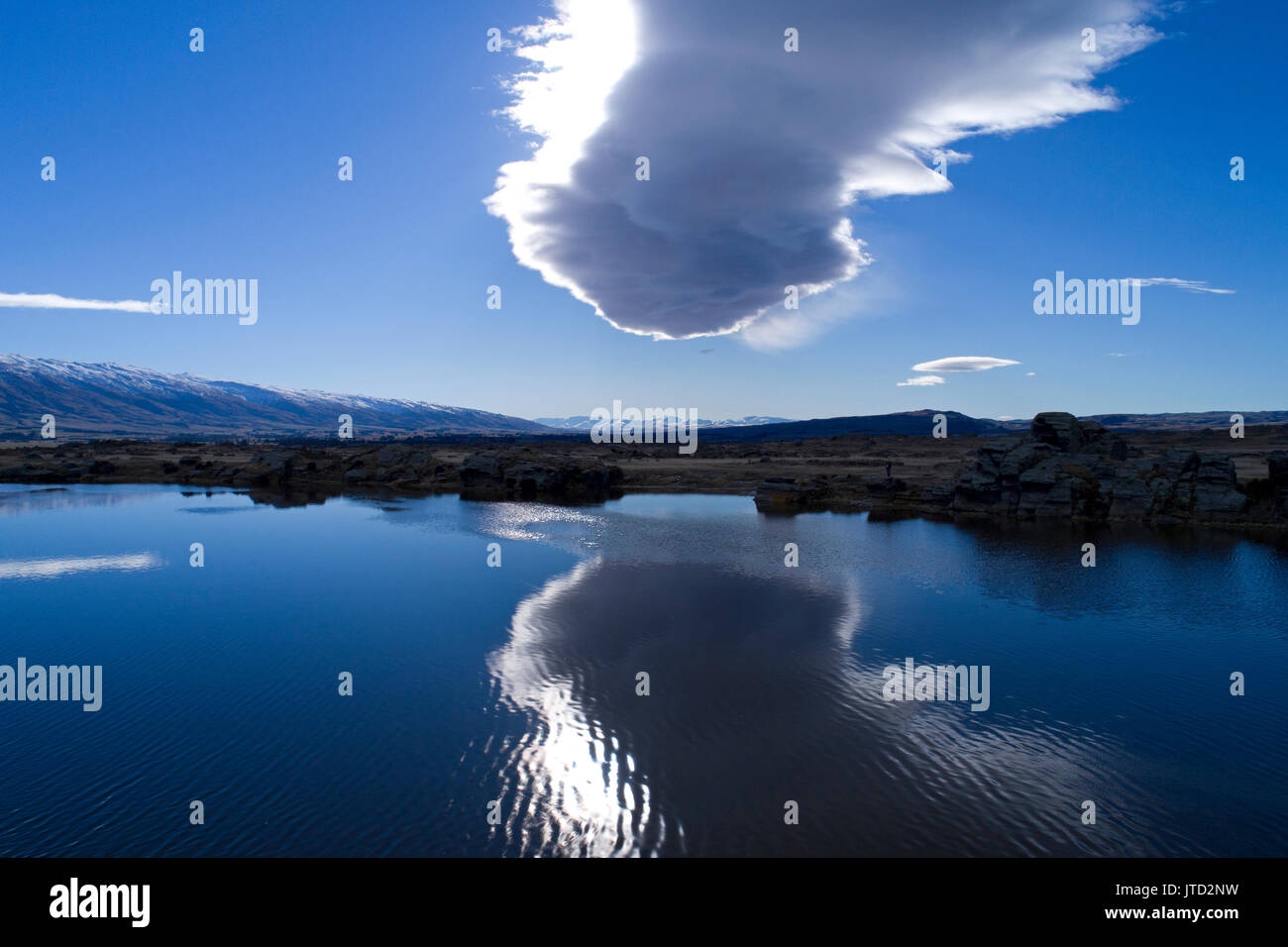 Sutton Salt Lake & 'The Taieri Pet' (lenticular billow cloud), Sutton, nr Middlemarch, Strath Taieri, Otago, South Island, New Zealand - drone aerial - Stock Image