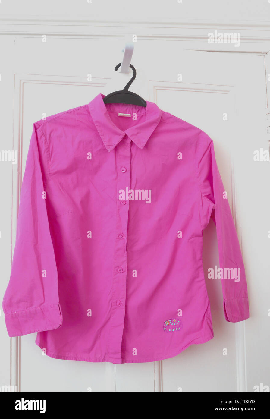 Pink Shirt with Elephant Embroidered on the bottom - Stock Image